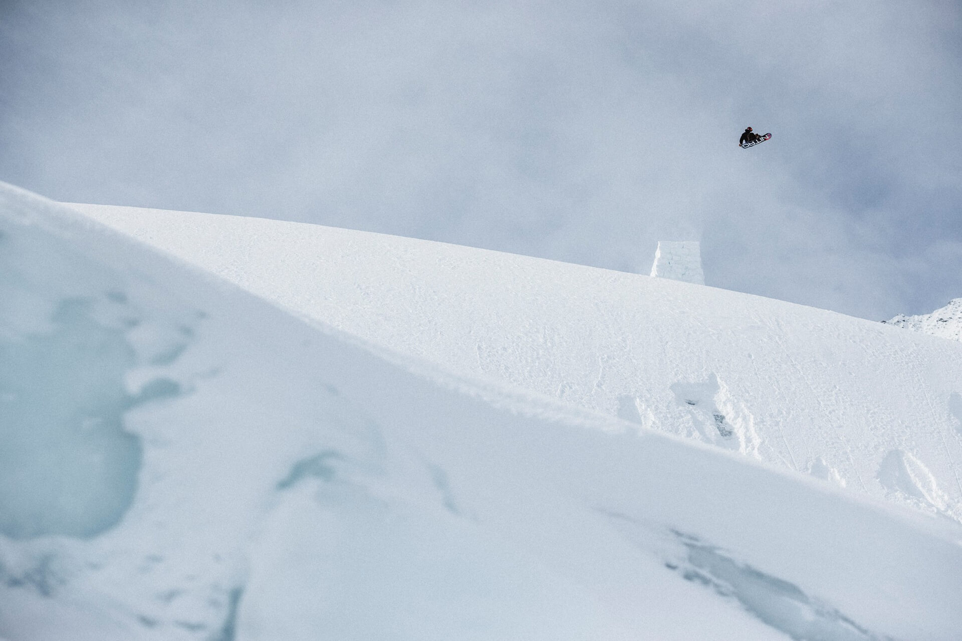 Haibike Hero Victor Delerue in the air on his snowboard after a big jump